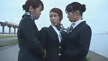 Three japanese airline stewardess kissing!