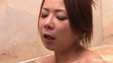 Naughty Asian girl plays with her pussy in the bathtub