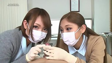 2 japanese nurses in latex gloves teasing patient