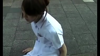 Japanese nurse with sprained foot in white nylon and bandage