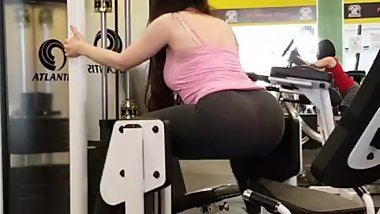 Brunette MILF big ass working out. she does squats in tight leggings thong!